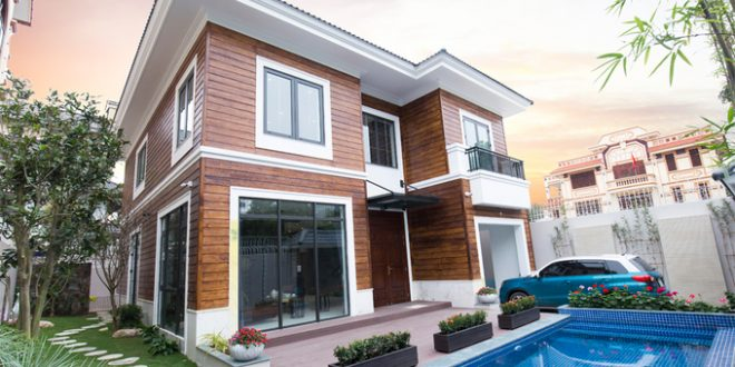 Mẫu biệt thự đẹp 2 tầng ốp gỗ hiện đại. 1